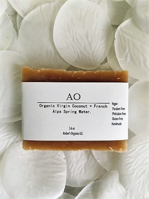 Organic Virgin Coconut + French Alps Spring Water.  Skin re-texturing Shine + Sheen